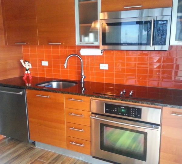تصميمات جدران المطابخ باللون البرتقالى